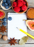 Top view of recipe book with ingredients Stock Photos