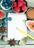 Top view of recipe book with ingredients Stock Images