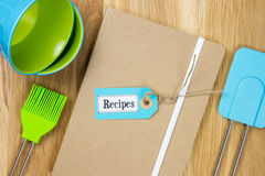 Top-view of a recipe book with kitchen utensils Royalty Free Stock Photos