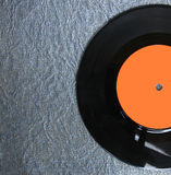 Top view of record over textured background Stock Photography
