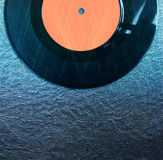 Top view of record over textured background and glitter lights Royalty Free Stock Photos
