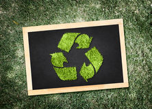 Top view of recycle symbol on blackboard with desaturated green Stock Images