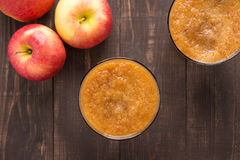 Top view red apples smoothie on wooden background Royalty Free Stock Photography