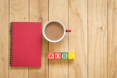 Top view of red book and coffee cup on wooden table. Background Stock Photos