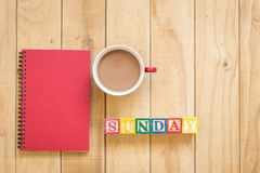 Top view of red book and coffee cup on wooden table. Background Royalty Free Stock Image