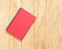 Top view of red book on wooden table Stock Photography