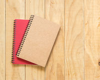 Top view of red and brown book on wooden table Royalty Free Stock Images