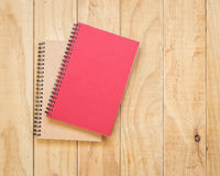 Top view of red and brown book on wooden table Stock Photos