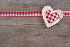 Top view of red checked heart decoration on wooden background - Royalty Free Stock Images