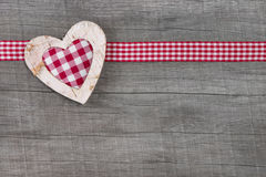 Top view of red checked heart decoration on wooden background - Royalty Free Stock Photo