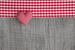 Top view of red checkered heart shape  on a wooden grey shabby b Royalty Free Stock Photography