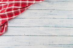Top of view red checkered tablecloth on wooden table royalty free stock photos