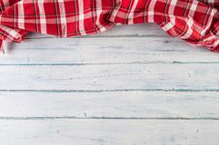 Top of view red checkered tablecloth on wooden table royalty free stock photography