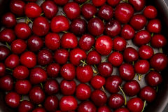 Top view of red cherry background. Top view of fresh red cherry with water drops stock images