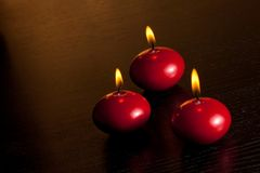 Top of view of red christmas candles on warm tint light background Royalty Free Stock Images