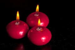 Top of view of red christmas candles on wood table background Royalty Free Stock Photos