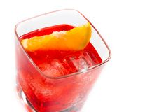 Top of view of red cocktail with orange slice isolated on white background Stock Photo