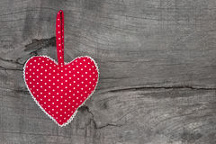 Top view of red dotted heart decoration on wooden background - c royalty free stock photography