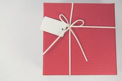 Top view of red gift box whit tie on white background. Space for product placement. Minimal concept Royalty Free Stock Photos