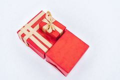 Top view of red gift boxes with golden ribbons. Isolated on grey royalty free stock image