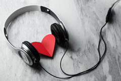 Top view of Red heart and headphone on white marble background. Stock Photo