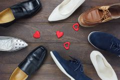 Top view red heart shape with fashionable several men`s shoes Royalty Free Stock Photography