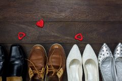 Top view red heart shape with fashionable several men`s shoes Stock Images