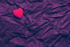 Top View Red Heart On Wrinkled Dark Purple Texture Background. Happy Valentine`s Day And Love Concept. Romantic Card, Banner