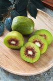 Top view of Red Kiiwfruit on Plate. Top view of Red Kiwifruit on wooden Plate stock photos