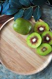 Top view of Red Kiwifruit with Copyspace. Top view of red kiwifruit on wooden plate with space for text royalty free stock image