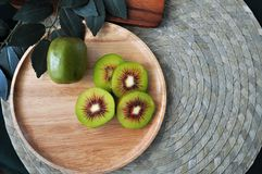 Top view of Red Kiwifruit on Wooden Plate. With copyspace royalty free stock photo