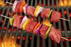 Top view of red meat skewers being grilled Stock Photo