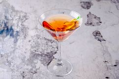 Top view red orange cocktail margareta fresh in a martini glass on a gray background. Bar alcohol drink menu, delicious. Tequila sunrise long drink for party Royalty Free Stock Photography