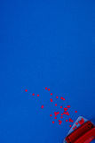 Top view of red puncher and paper pieces Royalty Free Stock Photography
