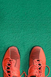 Top view of red sport shoes on green floor. Top view of red sport shoes on green background Stock Images