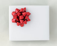 Top view of Red star ribbon on White paper box Stock Photo