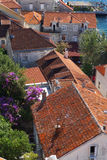 Top view of red tiled roofs and courtyards in a small town in Montenegro, travell Royalty Free Stock Photography