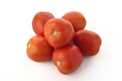 Top View of Red Tomatoes Stacked on White Background Stock Images
