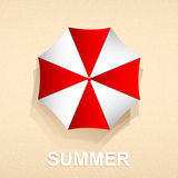 Top view of red and white umbrella on beach sand Stock Image