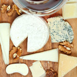 Top view of red wine glass and assorted cheeses royalty free stock photos