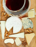 Top view of red wine glass and assortment cheeses Stock Image
