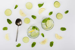 Top view of refreshing citrus beverages and spoon Stock Photography