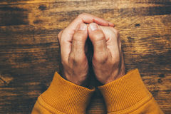 Top view of religious male crossed hands in prayer Royalty Free Stock Photography