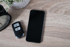 Top view remote keyless with blank screen smart phone Royalty Free Stock Images