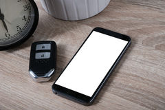 Top view remote keyless with blank screen smartphone Royalty Free Stock Images