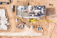 Top view of residential building under construction and yellow tower crane royalty free stock photography