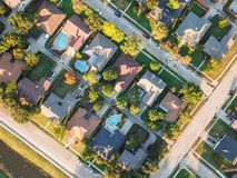 Top view residential dwelling units with swimming pool in fall season near Dallas, Texas. Aerial vertical view residential houses with swimming pool in royalty free stock images