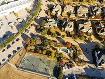 Top view residential tennis courts with players at autumn morning in North Texas, America. Aerial drone view park side residential neighborhood with community royalty free stock photography