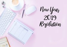 Top view 2019 resolution. Home office workspace - white modern keyboard with notebook on pink background stock photography