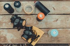 top view of respirators and cans with colorful spray paint royalty free stock photo